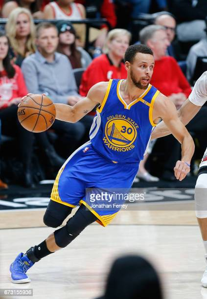 Stephen Curry of the Golden State Warriors dribbles with the ball against the Portland Trail Blazers during Game Four of the Western Conference...