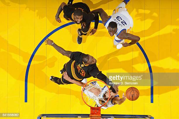 Stephen Curry of the Golden State Warriors drive to the basket around LeBron James of the Cleveland Cavaliers during the 2016 NBA Finals Game Seven...