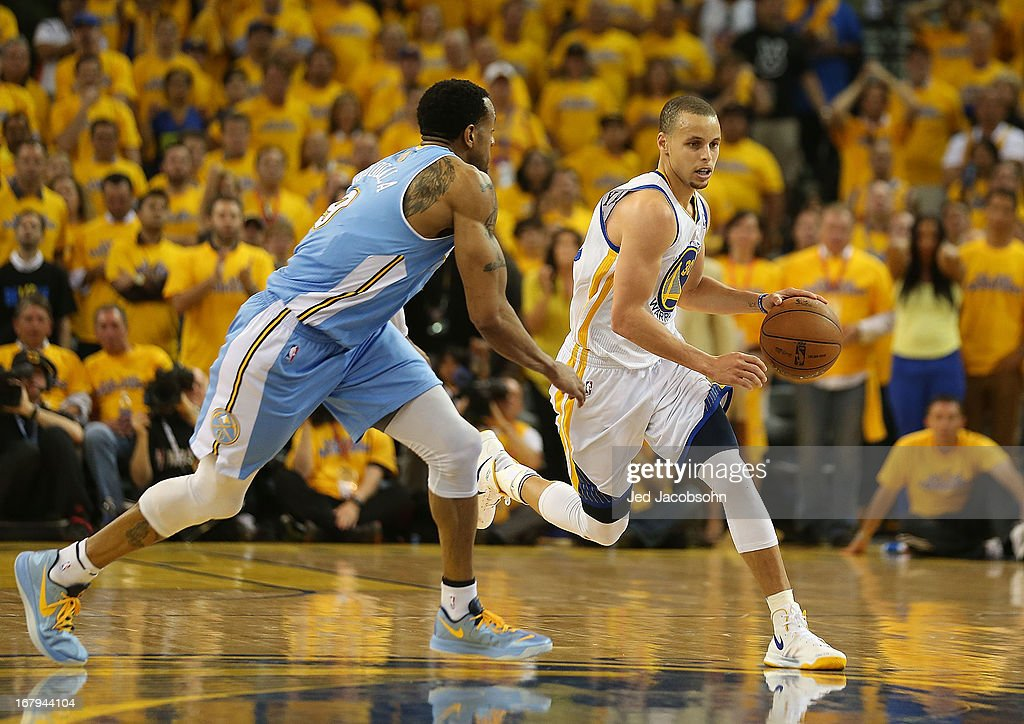 Stephen Curry #30 of the Golden State Warriors drives against Andre Iguodala #9 of the Denver Nuggets during Game Six of the Western Conference Quarterfinals of the 2013 NBA Playoffs at ORACLE Arena on May 2, 2013 in Oakland, California.