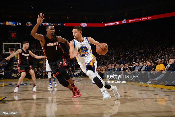 Stephen Curry of the Golden State Warriors drives against Chris Bosh of the Miami Heat on January 11 2016 at Oracle Arena in Oakland California NOTE...