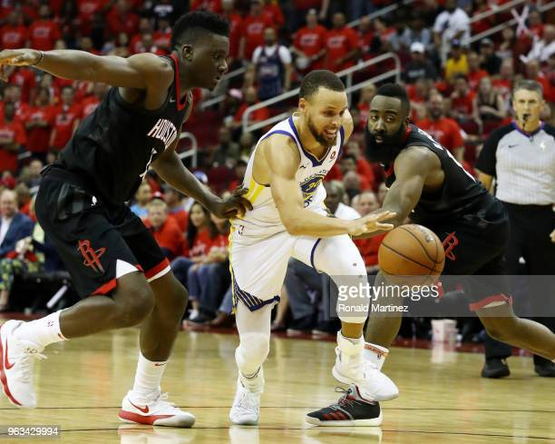 Stephen Curry of the Golden State Warriors drives against Clint Capela and James Harden of the Houston Rockets in the third quarter of Game Seven of...