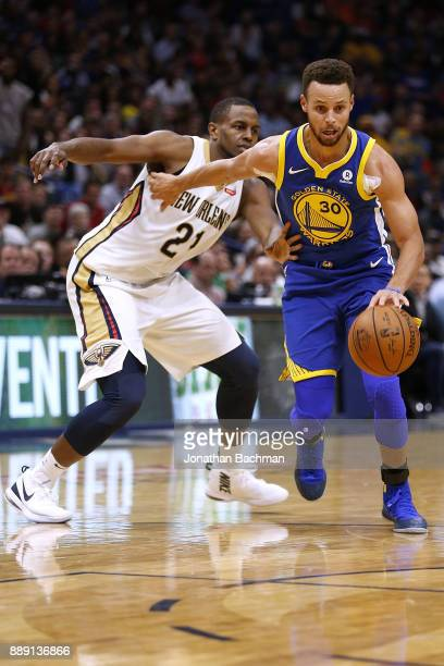 Stephen Curry of the Golden State Warriors drives against Darius Miller of the New Orleans Pelicans during the second half of a game at the Smoothie...