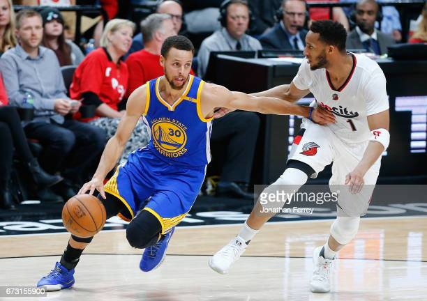 Stephen Curry of the Golden State Warriors drives against Evan Turner of the Portland Trail Blazers during Game Four of the Western Conference...