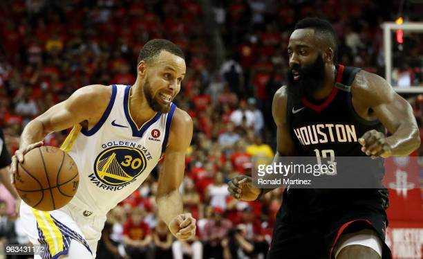 Stephen Curry of the Golden State Warriors drives against James Harden of the Houston Rockets in the second half of Game Seven of the Western...