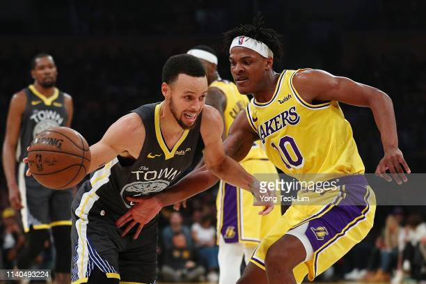 Stephen Curry of the Golden State Warriors drives against Jemerrio Jones of the Los Angeles Lakers during the first half at Staples Center on April...