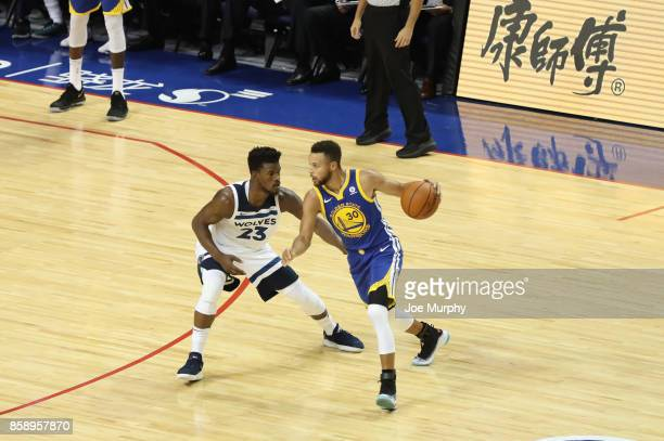 Stephen Curry of the Golden State Warriors drives against Jimmy Butler of the Minnesota Timberwolves as part of the 2017 Global Games China on...