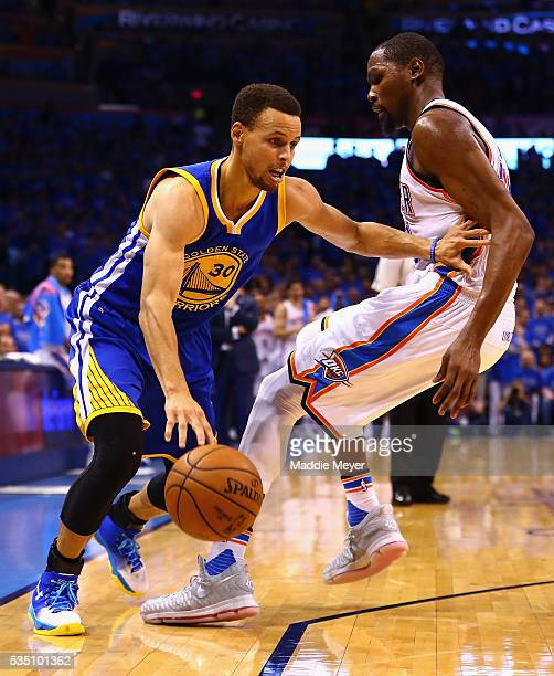 Stephen Curry of the Golden State Warriors drives against Kevin Durant of the Oklahoma City Thunder during the second half in game six of the Western...