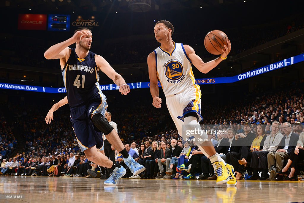 Stephen Curry #30 of the Golden State Warriors drives against Kosta Koufos #41 of the Memphis Grizzlies on April 13, 2015 at Oracle Arena in Oakland, California.