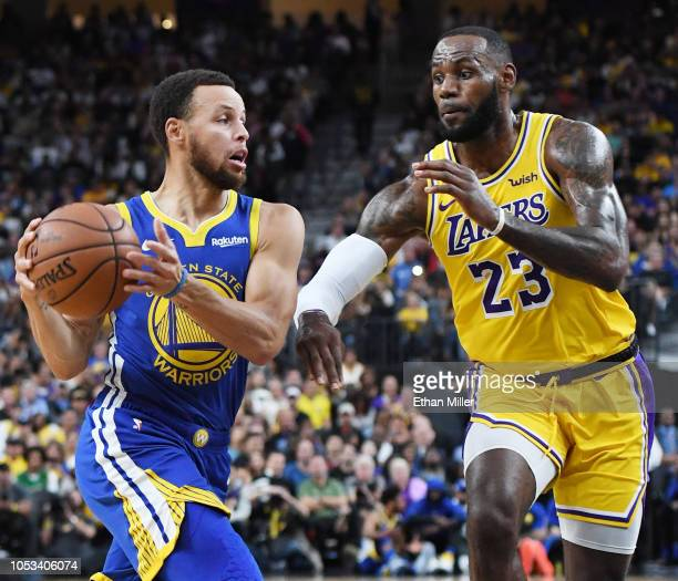 Stephen Curry of the Golden State Warriors drives against LeBron James of the Los Angeles Lakers during their preseason game at TMobile Arena on...