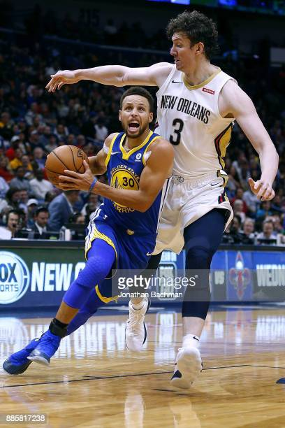 Stephen Curry of the Golden State Warriors drives against Omer Asik of the New Orleans Pelicans during the second half of a game at the Smoothie King...
