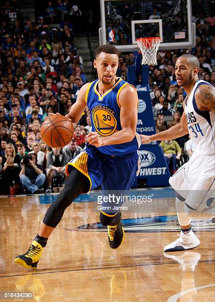 Stephen Curry of the Golden State Warriors drives against the Dallas Mavericks on March 18 2016 at the American Airlines Center in Dallas Texas NOTE...