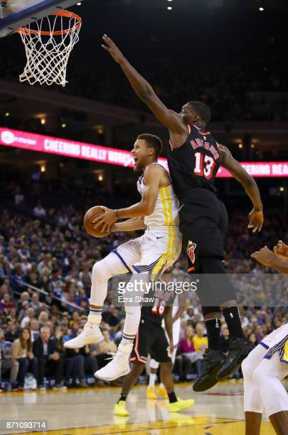 Stephen Curry of the Golden State Warriors drives on Bam Adebayo of the Miami Heat at ORACLE Arena on November 6 2017 in Oakland California NOTE TO...