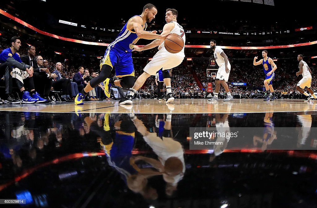Stephen Curry #30 of the Golden State Warriors drives on Goran Dragic #7 of the Miami Heat during a game at American Airlines Arena on January 23, 2017 in Miami, Florida.