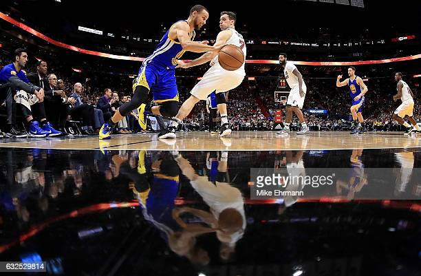 Stephen Curry of the Golden State Warriors drives on Goran Dragic of the Miami Heat during a game at American Airlines Arena on January 23 2017 in...