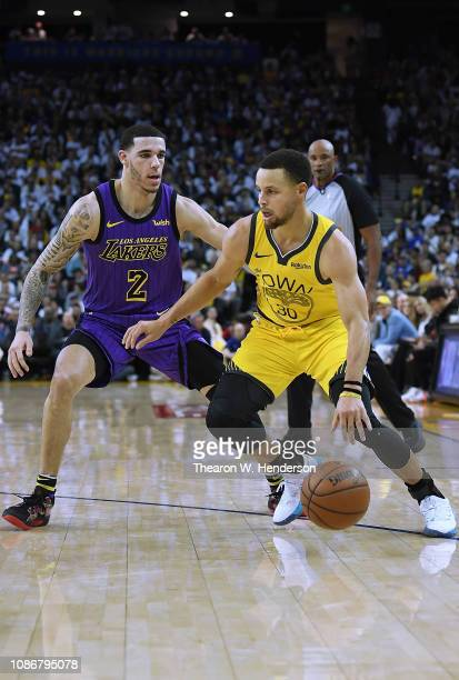 Stephen Curry of the Golden State Warriors drives on Lonzo Ball of the Los Angeles Lakers during the second half of their NBA Basketball game at...