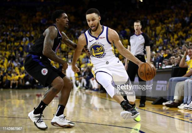 Stephen Curry of the Golden State Warriors drives on Lou Williams of the LA Clippers during Game One of the first round of the 2019 NBA Western...