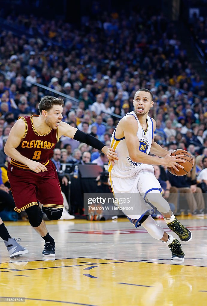 Stephen Curry  30 of the Golden State Warriors drives on Matthew Dellavedova   8 of 1a8b11aca