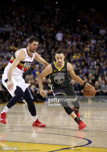 Stephen Curry of the Golden State Warriors drives on Nikola Mirotic of the New Orleans Pelicans at ORACLE Arena on January 16 2019 in Oakland...