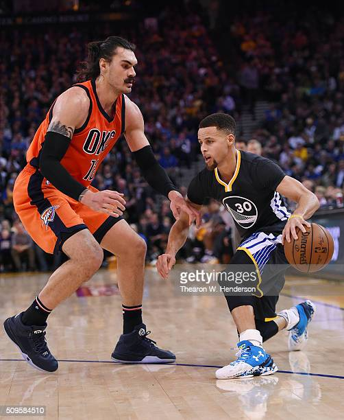 Stephen Curry of the Golden State Warriors drives on Steven Adams of the Oklahoma City Thunder during an NBA basketball game at ORACLE Arena on...