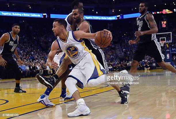 Stephen Curry of the Golden State Warriors drives on Tony Parker of the San Antonio Spurs during an NBA Basketball game at ORACLE Arena on April 7...