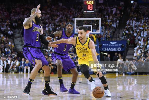 Stephen Curry of the Golden State Warriors drives on Tyson Chandler of the Los Angeles Lakers during the second half of their NBA Basketball game at...