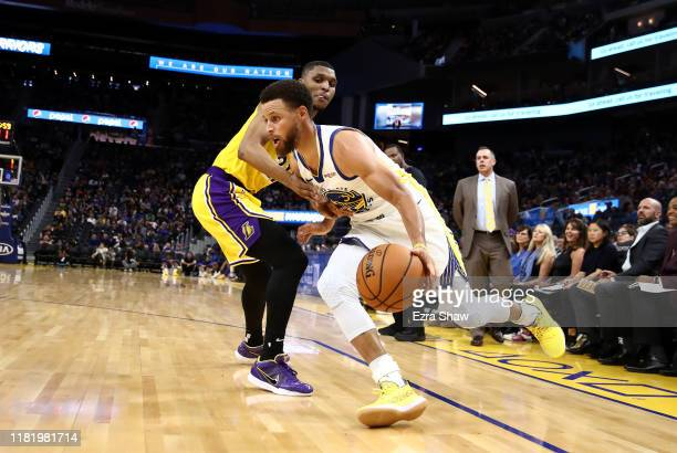 Stephen Curry of the Golden State Warriors drives on Zach Norvell Jr #21of the Los Angeles Lakers at Chase Center on October 18 2019 in San Francisco...