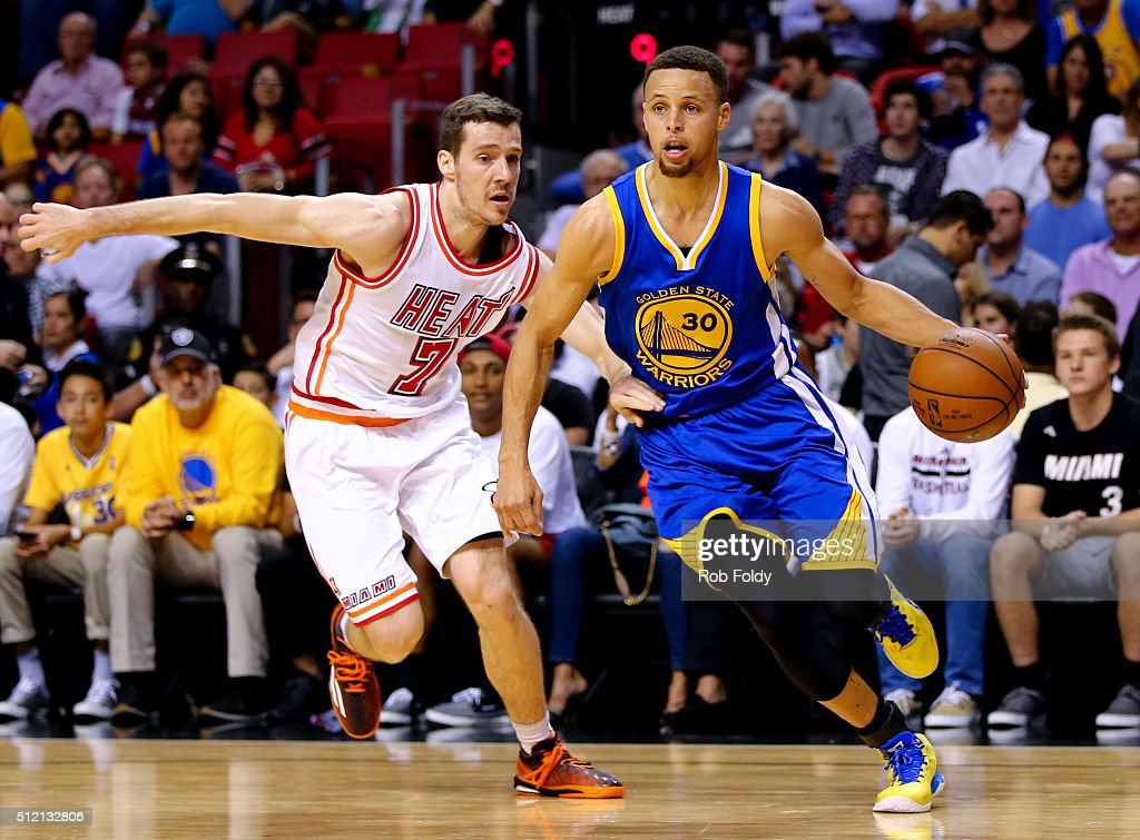 Stephen Curry #30 of the Golden State Warriors drives past Goran Dragic #7 of the Miami Heat during the game at the American Airlines Arena on February 24, 2016 in Miami, Florida.