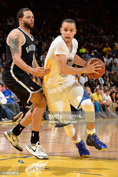 Stephen Curry of the Golden State Warriors drives to the basket during a game against the Brooklyn Nets at Oracle Arena on February 22 2014 in...