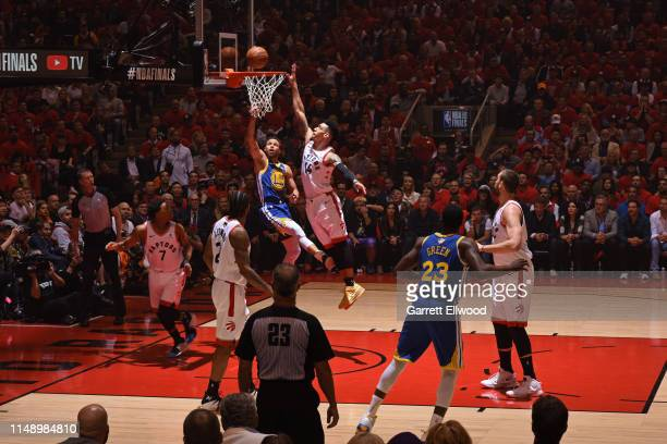 Stephen Curry of the Golden State Warriors drives to the basket and shoots the ball against the Toronto Raptors during Game Five of the NBA Finals on...
