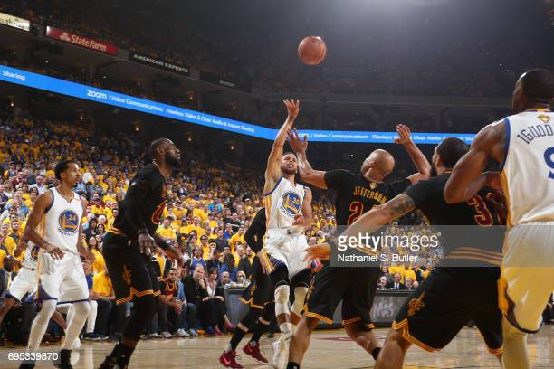 Stephen Curry of the Golden State Warriors drives to the basket and shoots the ball against the Cleveland Cavaliers in Game Five of the 2017 NBA...