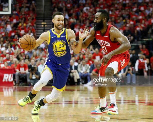 Stephen Curry of the Golden State Warriors drives to the basket defended by James Harden of the Houston Rockets in the third quarter during Game Four...