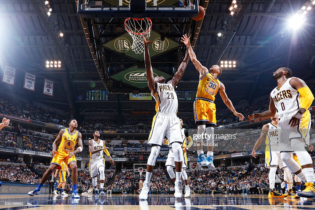 Stephen Curry #30 of the Golden State Warriors drives to the basket against Ian Mahinmi #28 of the Indiana Pacers in the second half of the game at Bankers Life Fieldhouse on December 8, 2015 in Indianapolis, Indiana. The Warriors defeated the Pacers 131-123 to move to 23-0 on the season.