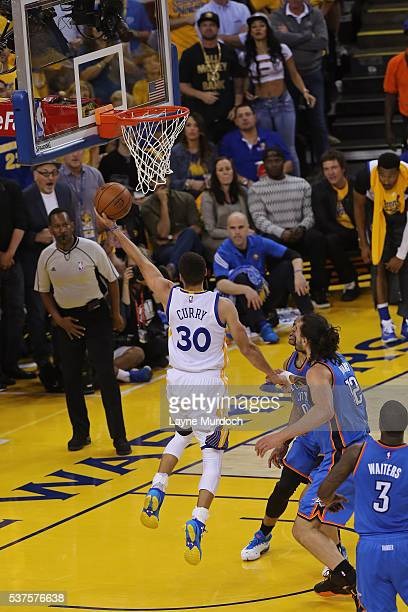 Stephen Curry of the Golden State Warriors drives to the basket in Game Five of the Western Conference Finals against the Oklahoma City Thunder...