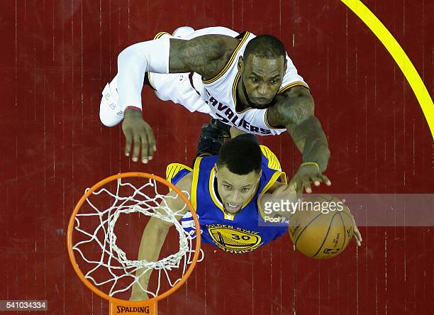 Stephen Curry of the Golden State Warriors drives to the basket in the second half against LeBron James of the Cleveland Cavaliers in Game 6 of the...