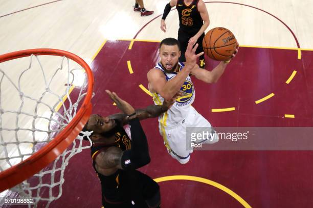 Stephen Curry of the Golden State Warriors drives to the basket in the second half against LeBron James of the Cleveland Cavaliers during Game Four...