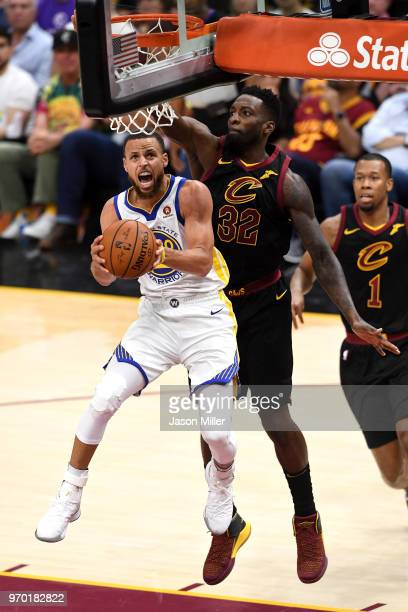 Stephen Curry of the Golden State Warriors drives to the basket against Jeff Green of the Cleveland Cavaliers in the second half during Game Four of...