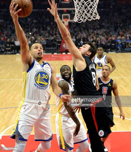 Stephen Curry of the Golden State Warriors drives to the basket against Danilo Gallinari of the Los Angeles Clippers during the first half at Staples...