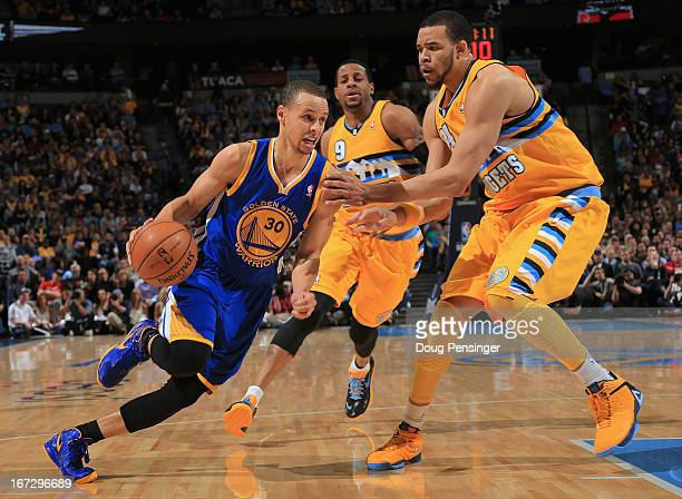 Stephen Curry of the Golden State Warriors drives to the basket against JaVale McGee of the Denver Nuggets during Game Two of the Western Conference...
