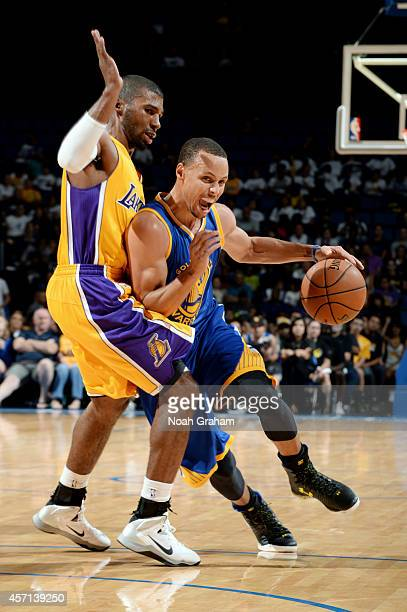 Stephen Curry of the Golden State Warriors drives to the basket against Ronnie Price of the Los Angeles Lakers on October 12 2014 at Citizens...