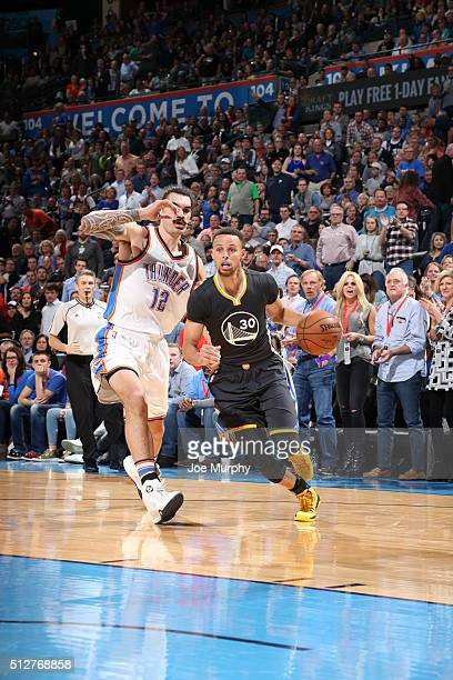 Stephen Curry of the Golden State Warriors drives to the basket against Steven Adams of the Oklahoma City Thunder on February 27 2016 at Chesapeake...