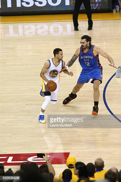 Stephen Curry of the Golden State Warriors drives to the basket against Steven Adams of the Oklahoma City Thunder in Game Seven of the Western...