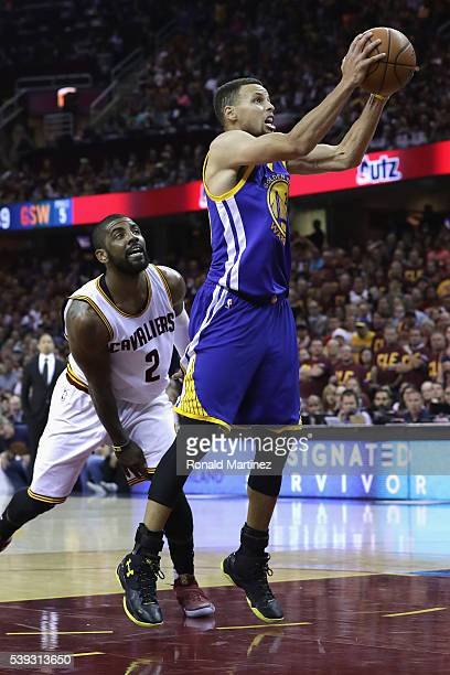 Stephen Curry of the Golden State Warriors drives to the basket against Kyrie Irving of the Cleveland Cavaliers during the first half in Game 4 of...