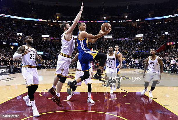 Stephen Curry of the Golden State Warriors drives to the basket against Kevin Love of the Cleveland Cavaliers during the second half in Game 6 of the...