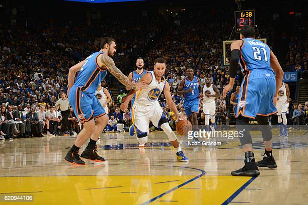 Stephen Curry of the Golden State Warriors drives to the basket against Steven Adams of the Oklahoma City Thunder during a game on November 3 2016 at...