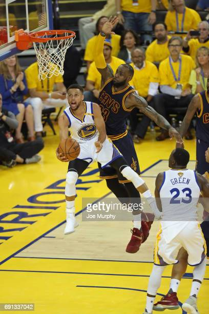 Stephen Curry of the Golden State Warriors drives to the basket around LeBron James of the Cleveland Cavaliers in Game One of the 2017 NBA Finals on...