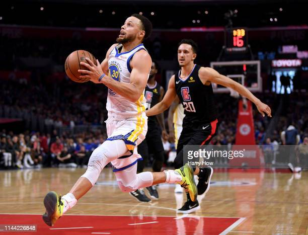 Stephen Curry of the Golden State Warriors drives to the basket past Landry Shamet of the LA Clippers during a 113105 Warrior win in Game Four of...