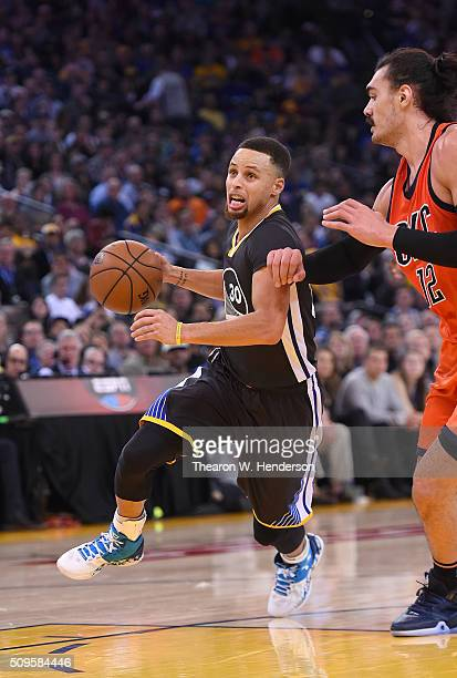 Stephen Curry of the Golden State Warriors drives to the basket past Steven Adams of the Oklahoma City Thunder during an NBA basketball game at...