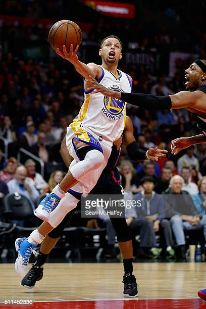 Stephen Curry of the Golden State Warriors drives to the basket past Paul Pierce of the Los Angeles Clippers during the first half of a game at...