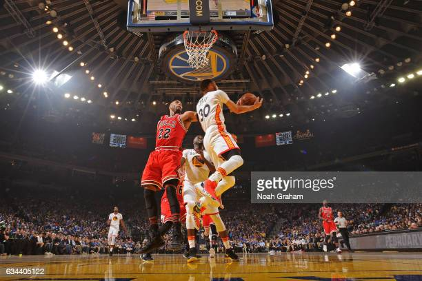 Stephen Curry of the Golden State Warriors drives to the basket around Taj Gibson of the Chicago Bulls on February 8 2017 at ORACLE Arena in Oakland...