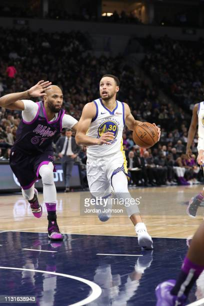 Stephen Curry of the Golden State Warriors drives to the basket against the Minnesota Timberwolves on March 19 2019 at Target Center in Minneapolis...